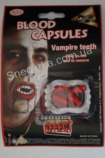 Вампирские зубы с кровью